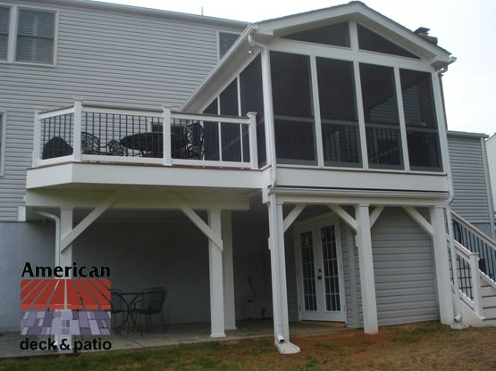 Low maintenance Screened Porch with Storage Shed Removable screen panels. Built in storage room under porch. Vinyl rails with black balusters and composite rail cap.