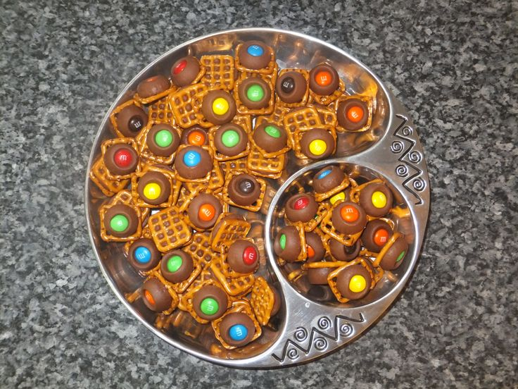 Pretzel Rolo Snacks - We usually do Hershey Kisses with M&Ms and put ...