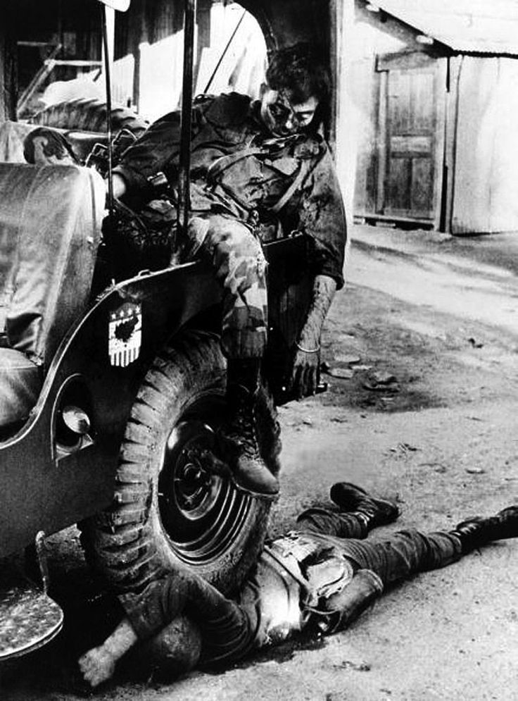 January 1968, Saigon, South Vietnam, A South Vietnamese major lies dead, slumped in a jeep after being shot in the face by Viet Cong guerillas.. .
