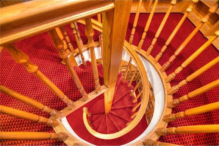 Trouble me not with facts about the inefficiency and danger of spiral staircases.  It's my life, and I will live it how I choose.