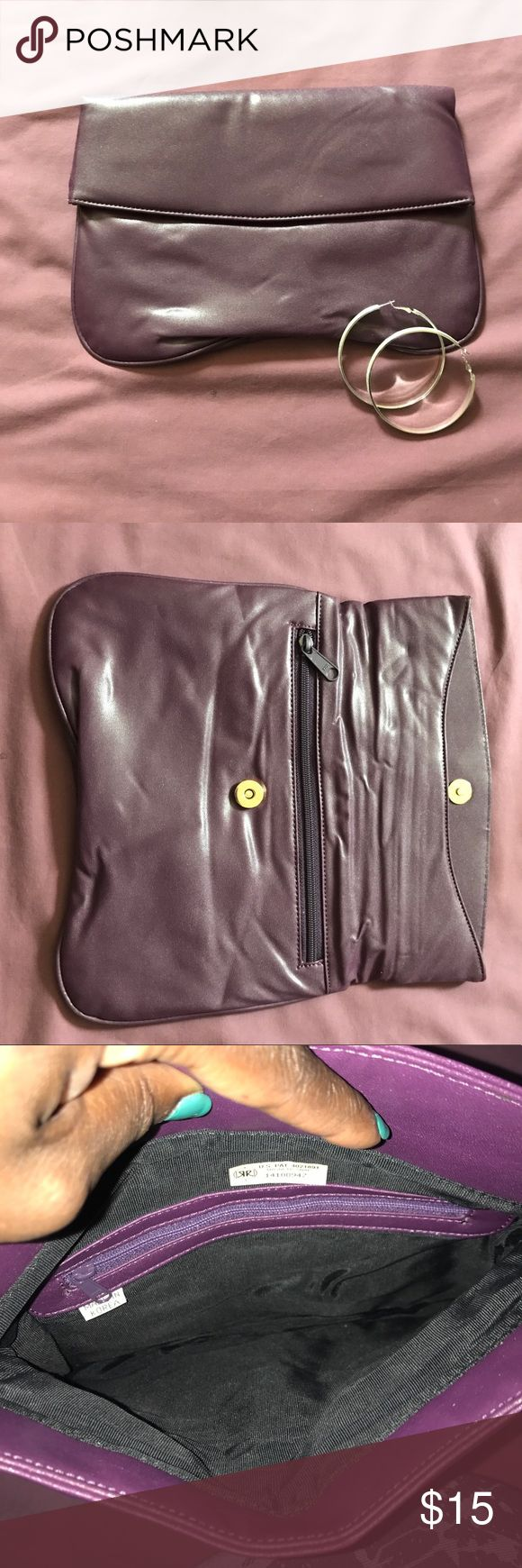 Simple Purple Clutch A cute and roomy clutch perfect for date night or girls night out. Interior and exterior in good condition. Bags Clutches & Wristlets