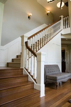 Adding class to a 90's house traditional-staircase