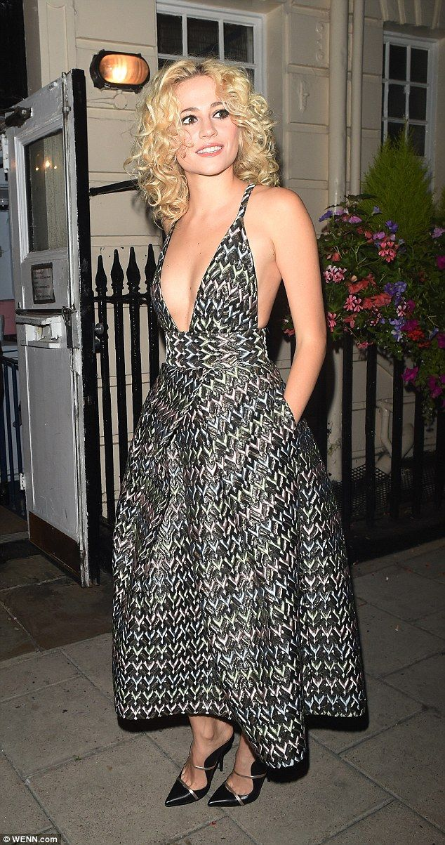 Treading the boards: Pixie Lott looked like she'd enjoyed yet another triumphant performance in Breakfast At Tiffany's, beaming as she left the Haymarket Theatre in London on Tuesday night