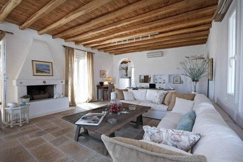 A home in the village of Mykonos has style.  Byzantine stone floors, white walls, and comfortable seating makes me think...where is my ticket?