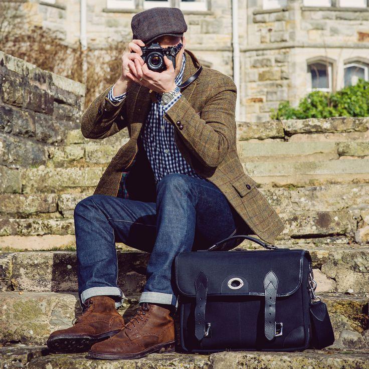 hawkesmillbags:    Todays shot kit: Canon A-1 Levis 511 Selvedge jeans tweed jacket Crockett and Jones Islay boots and our Bond Street camera bag.   Hawkesmill England  Follow us on Instagram