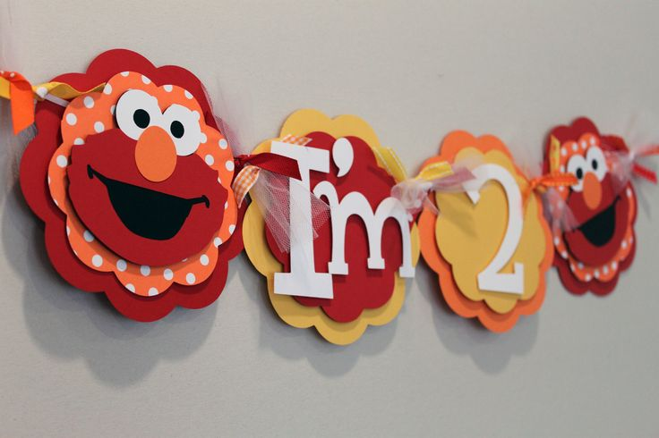 Elmo Red Yellow and Orange High Chair Banner by PaisleyGreer, via Etsy.