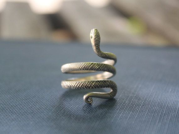This dainty ring to subtly show off their mascot. | 35 Things To Buy Your Favorite Slytherin