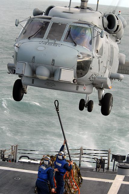 USS Boone Sailors attach supplies to Sea Hawk by Official U.S. Navy Imagery