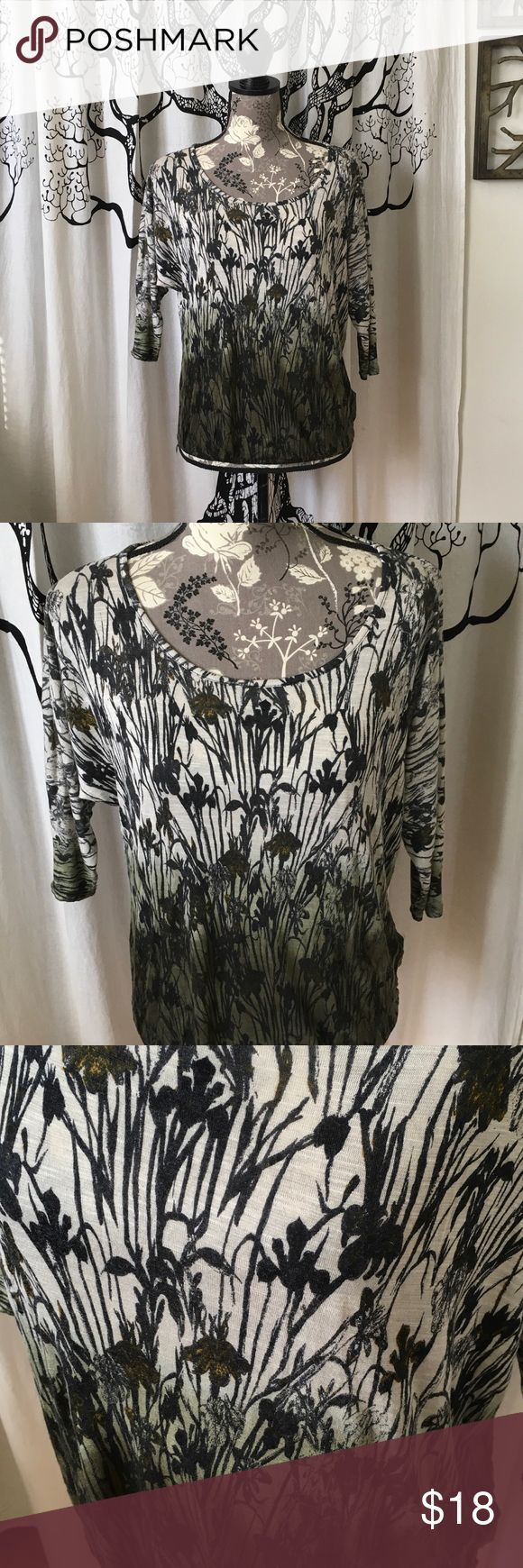 """Anthropologie Ella Moss Soft Floral Top SZ S Gorgeous, amazingly soft batwing top by Ella Moss for Anthropologie in beautiful greens, black and dark yellow on cream. Elastic band at the hem. Perfect, like new condition. Note there is a small area on the arm where the green dye is slightly out of place. This is not a stain; it was purchased this way and totally blends in with the design. Lightweight, super soft rayon. SZ S. Accommodates most bust sizes, 25"""" L. Beautiful for spring…"""