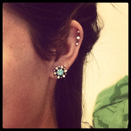 ear piercings. Love the triple cartilage!