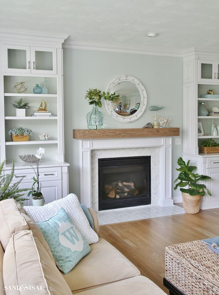 Coastal Familyroom with Builtins and Wood Beam Fireplace        ..paint=Seasalt sherwinwilliams