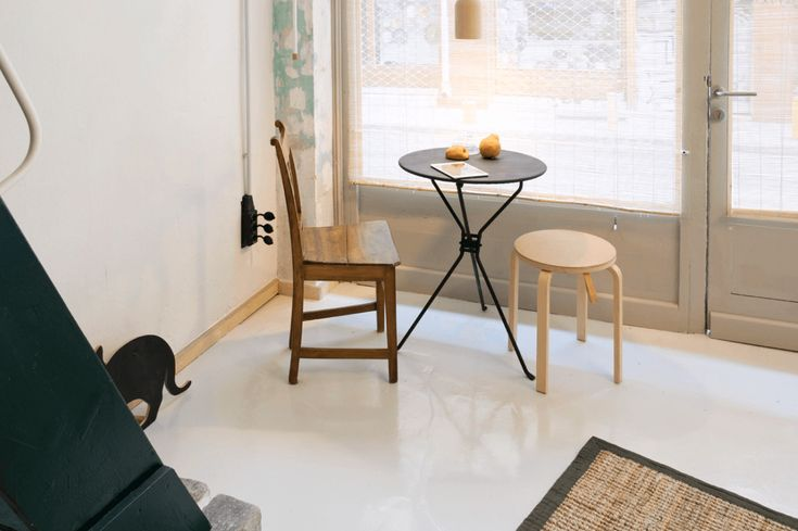 Small-scale furniture keeps the space feeling open, as shown here, in the mix-and-match dining area. A petite rug emphasizes the empty floor space and keeps the room feeling sparse.