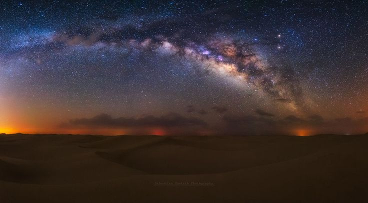 A panorama shot of the Milky Way over the desert, taken in a very remote part of the desert where light pollution levels are very low.It is still Milky Way season so go out and give it a try !