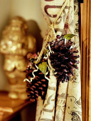 Christmas Window Charm  Delight your guest by using glittered pinecones to spruce up guest room decor. These easy-to-make Christmas pinecone curtain tiebacks are the perfect way to dress up drapes for the holidays!! Can use red satin cord or festive ribbon!!