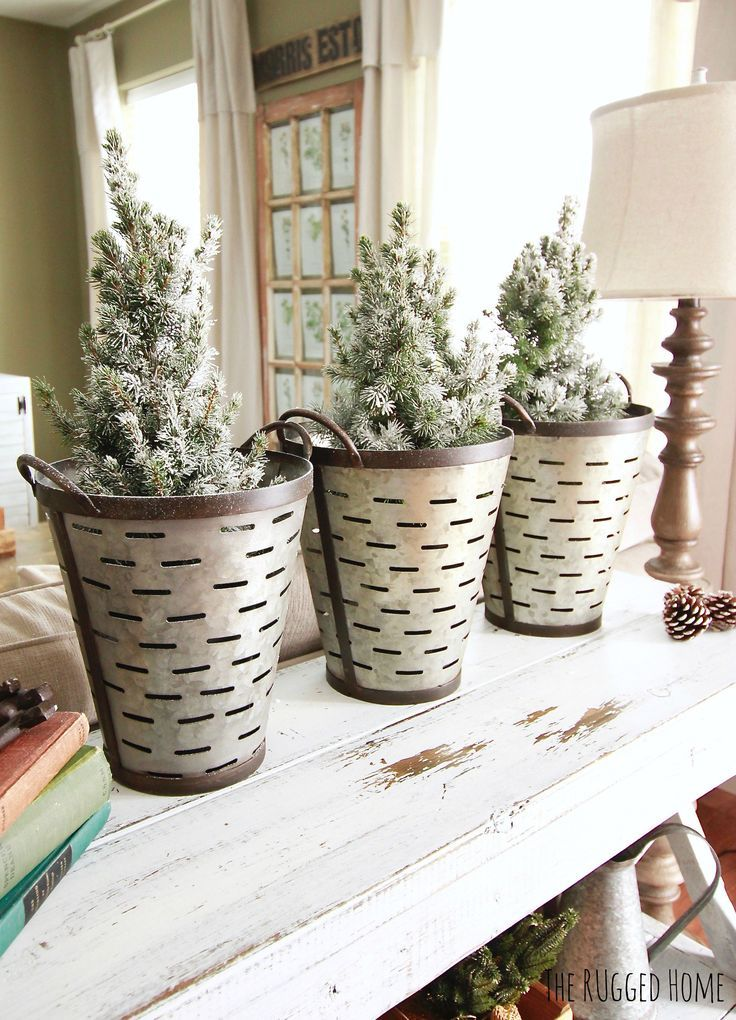 Decorating with Charlie Brown Christmas Trees and Olive Buckets for a total Farmhouse chic Christmas www.theruggedrooster.com