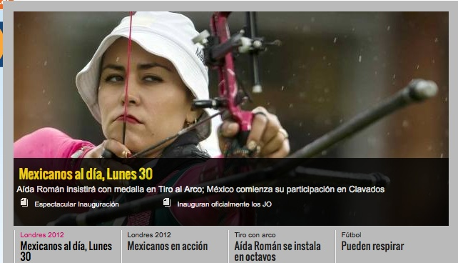 108a: The picture shows a female archer aiming her bow.  The side angle framing places emphasis on the concentration of her pose and allows the viewer to look straight into her eyes. The shallow depth of field shows rain falling, adding to the drama of the shot.  The overall image is a powerful depiction of feminity not normally seen