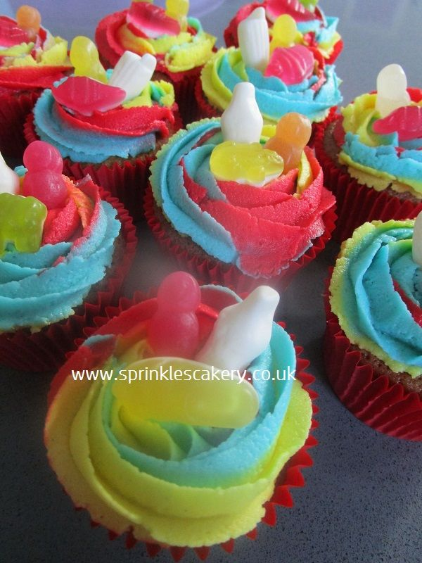 Triple swirl haribo cupcakes for a 4 year old birthday boy. The primary coloured buttercream makes for quite a striking design.