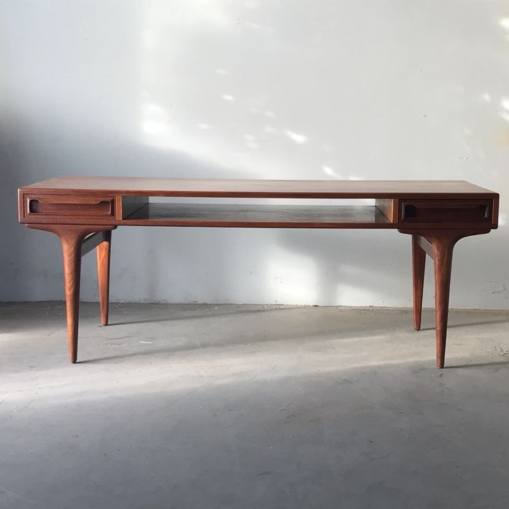 Teak Danish coffee table with double ended drawers