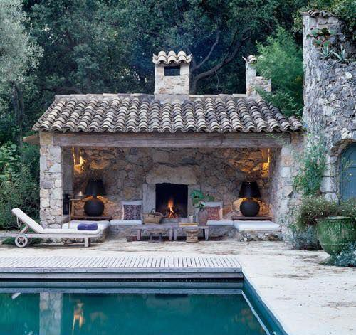 Mediterranean farmhouse plaster walls terra cotta roof tiles natural sea water pool