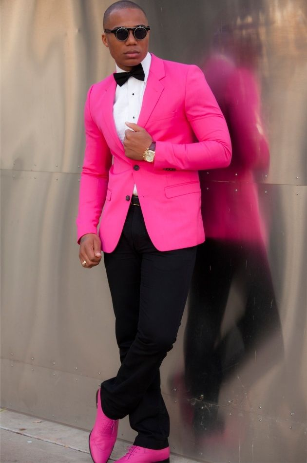 Shop this look on Lookastic:  https://lookastic.com/men/looks/blazer-dress-shirt-chinos-oxford-shoes-bow-tie-belt-sunglasses/13082  — Black Sunglasses  — Black Bow-tie  — White Dress Shirt  — Hot Pink Blazer  — Black Leather Belt  — Black Chinos  — Hot Pink Leather Oxford Shoes