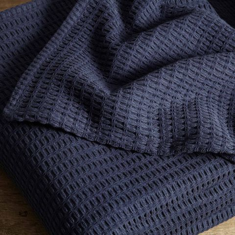 <p>• Cotton throw for an Emperor sized bed<br />• Honeycomb pattern is update on traditional waffle weave<br />• Waffle weave results in a soft, weighty fabric<br />• Available in shades of indigo and taupe<br />• Found in the cabins at Soho Farmhouse</p>
