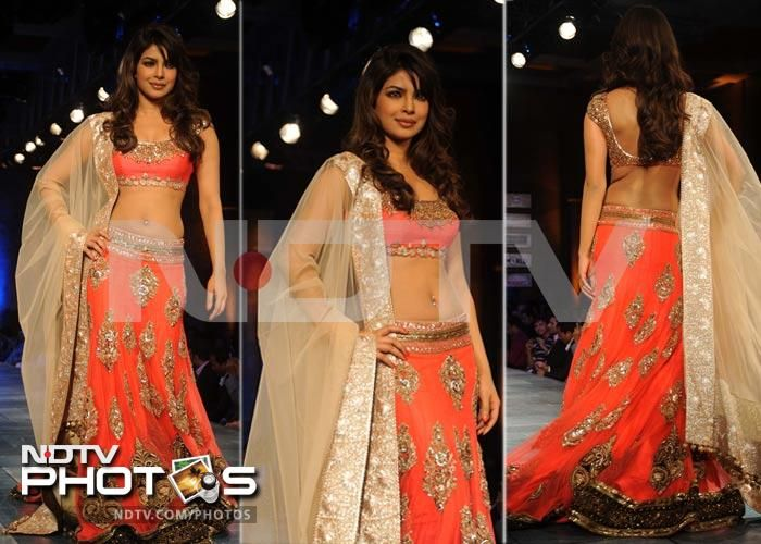 Priyanka Chopra looked ravishing in her orange and gold lehenga. The Barfi! actress and budding singer also showed off a bejeweled belly button.: Belly Button, Photo
