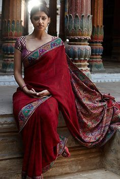 Deep red Saree with richly colored embro. trim #Saree by L'affaire, Delhi http://www.laffaire.net/html/index.html ~
