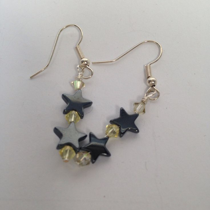 Black star earrings by ChellysGems on Etsy