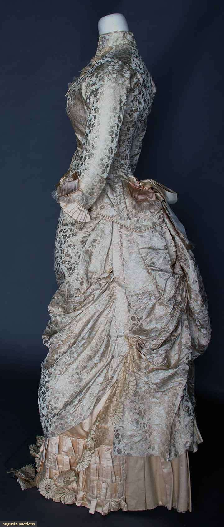 "SILK BROCADE WEDDING DRESS, 1880 2-piece, pale pink brocade flowers on cream silk faille, bodice & skirt trimmed w/ blonde lace, removable ruffled modesty neckpiece, cotton, satin & buckram linings, B 32"", W 24"", Skirt L 42"""
