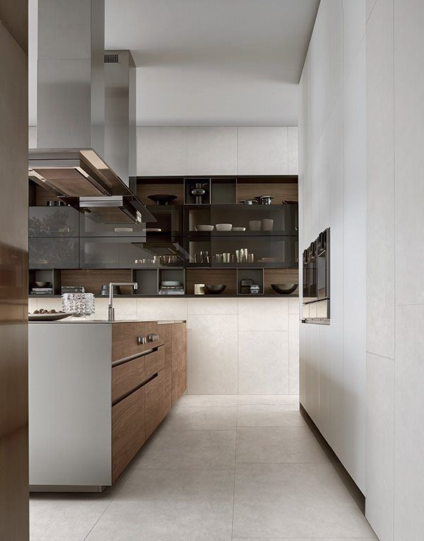 Euorpean kitchen varenna by poliform sophisticated palette of materials travertine timber veneer paint stainless steel