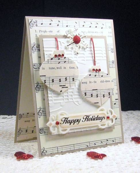 Singing Ornaments by pam124 - Cards and Paper Crafts at Splitcoaststampers. Uses digital music but could use real sheet music (or book pages for a different look)