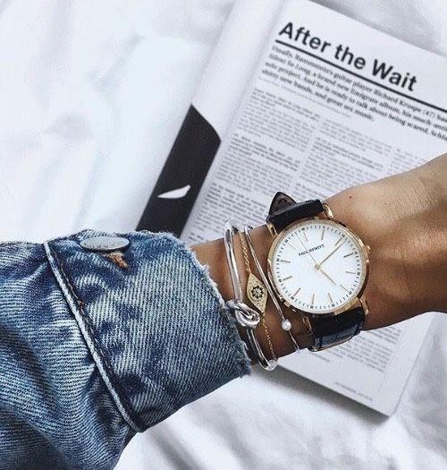 Layered Arm Candy - mixed metallic bracelets layered with a black strap watch