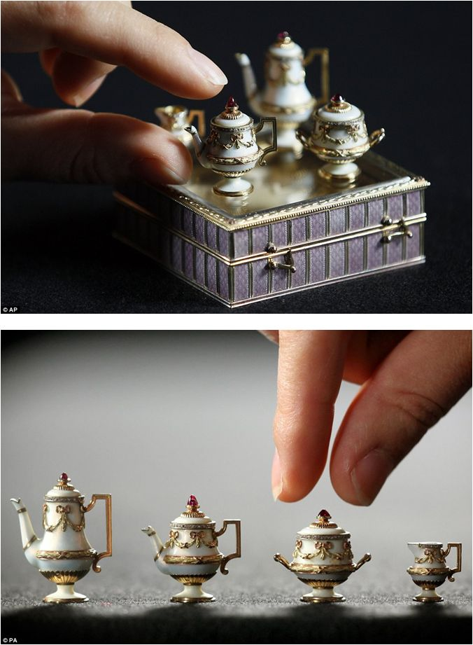 Miniature Tea Set by Russian jeweller & goldsmith Peter Carl Fabergé. It is part of more than 100 items collected by the Royal Family since the reign of Queen Victoria. The set measures just 1cm in height & was originally owned by Queen Alexandra of Denmark.