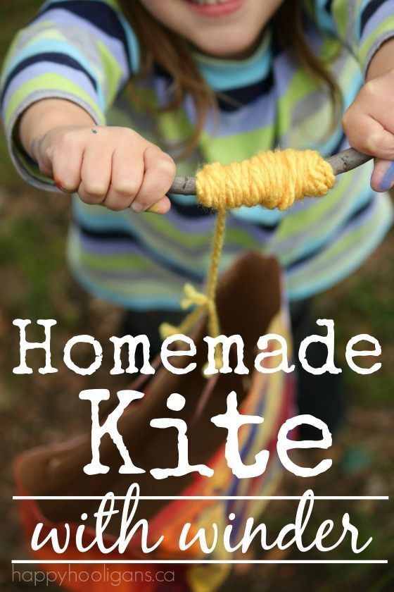 Homemade Paper Bag Kite with Winder - a quick and easy kite craft for toddlers and preschoolers.  Great spring craft or a craft for a windy day at any time of year.  The simple winder handle adds a fine motor element to flying this kite, and it's so much fun for little ones to use. - Happy Hooligans