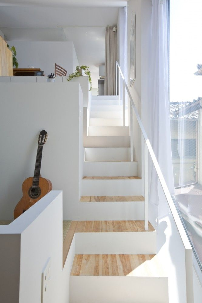 levels + stairs by Komada Architects