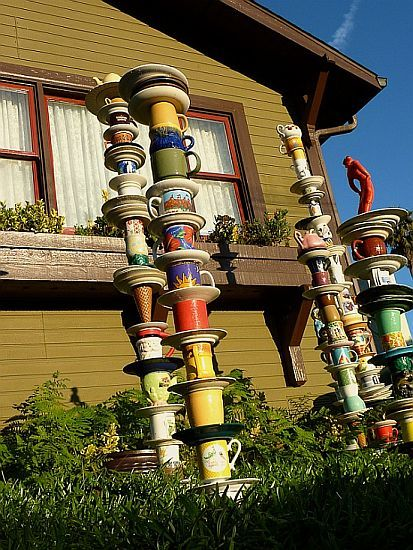 Mad Hatter Cups - art deco for the garden. Now I know what to do with all the extra coffee cups I have.