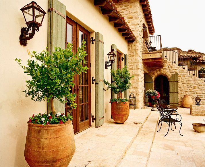 These green shutters to exterior windows In the front. Mediterranean Tuscan Home/House Exterior