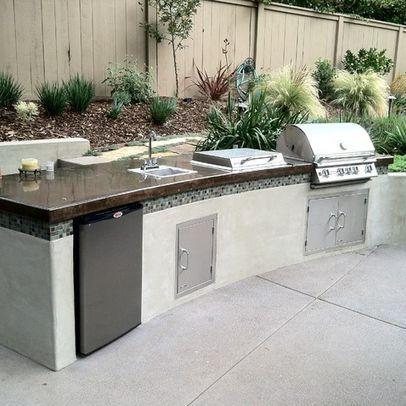 Modern Outdoor Kitchen Design Idea - is it also a berm?