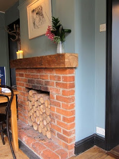 Brick fireplace with logs (from The British Larder, Suffolk)