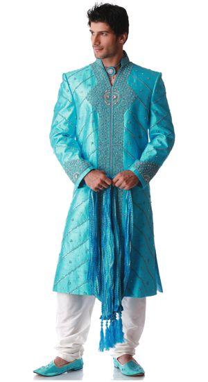 raw silk sherwai desiged with sequis, beads, stoe, cutdaa & zardosi work. Has embroidery o frot border, collar, shoulder ad cuffs. Comes with a off white pajama