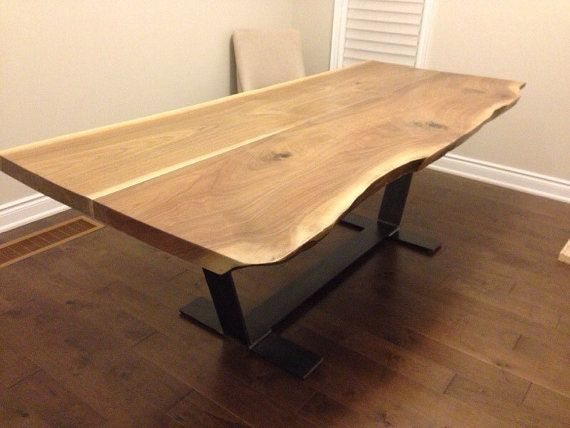 Live edge walnut dining table with custom pedestal by PlankToTable