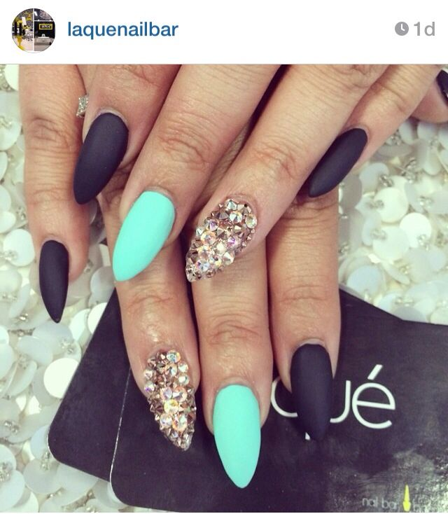 Pointed nails, matte black, turquoise and diamonds. A must for the summer I think.