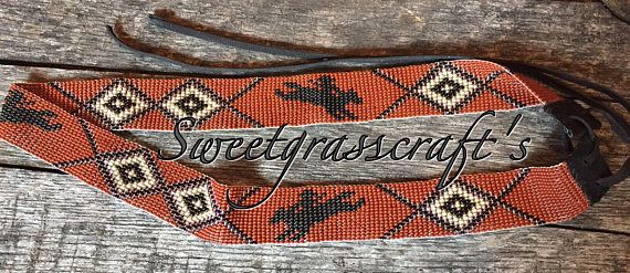 Striking Cowboy Hat Band with Bronc riders, perfect for all rodeo lovers. This hat band measures 24 inches long by 1 1/4 wide, long ties done in black kid leather to fit any sized hat, these also have vintage brown lined beads setting off the diamond shapes. Double hole in back so