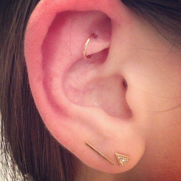 Rook piercing w/ rose gold. Bar earring by @brvtvs. #jcolbysmithpiercing