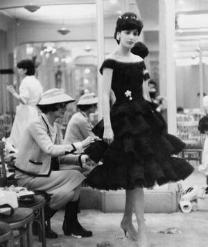 Rare picture of Coco Chanel at work with a model adjusting her dress.   #vintage #fashion #designer #working #model #1940s #1950s #1960s