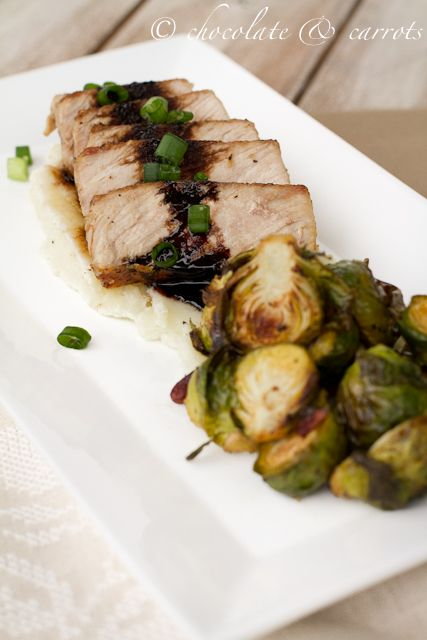 Seared greek pork loin chop, drizzled with balsamic reduction, over a ...