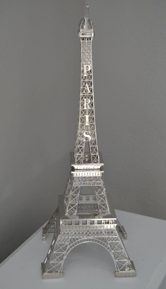 Eiffel Tower romantique wedding, party & event decor. The magnifique design of these french inspired Eiffel Towers are sure to be eye catching at your Paris themed soirée wedding or party! Most commonly used as event table decor, wedding centerpieces, paris themed party decor, or cake topper.   Constructed of durable metal and beautifully painted with your choice of Antique Gold, Brilliant Silver, White, or Gold. Antique Gold color photos 1-3 Gold color photo 4  Also available, -Eiffel Tower…