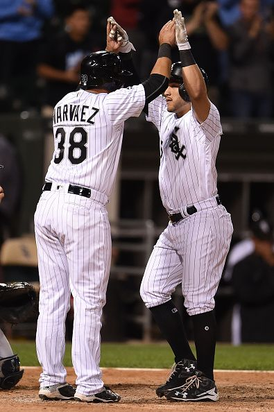 Carlos Sanchez of the Chicago White Sox celebrates with Omar Narvaez following an eighth inning home run against the Tampa Bay Rays at US Cellular...