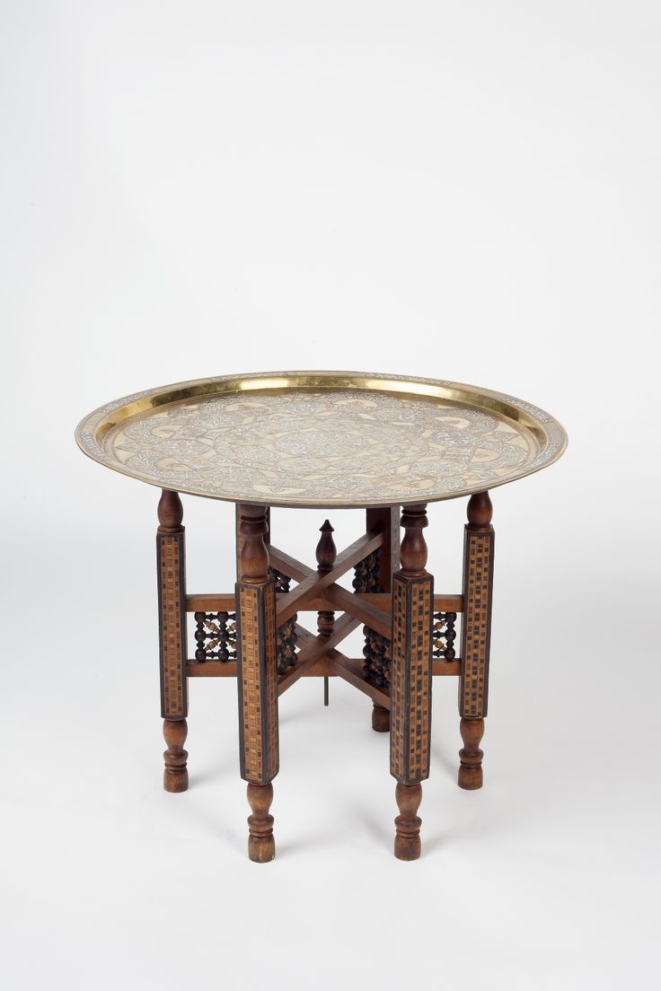 A Damascus silver inlaid tray with stand decorated with scripture and geometric patterns, 64cm di
