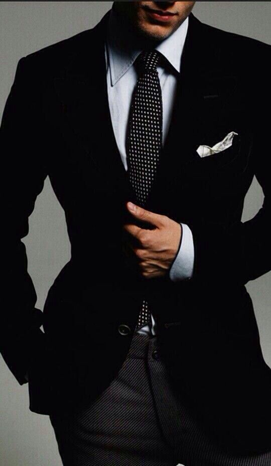 Style and fashion for men. Black and pattern suit.